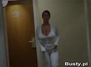 Voluptuous Bea Flora walking topless in a hotel corridor